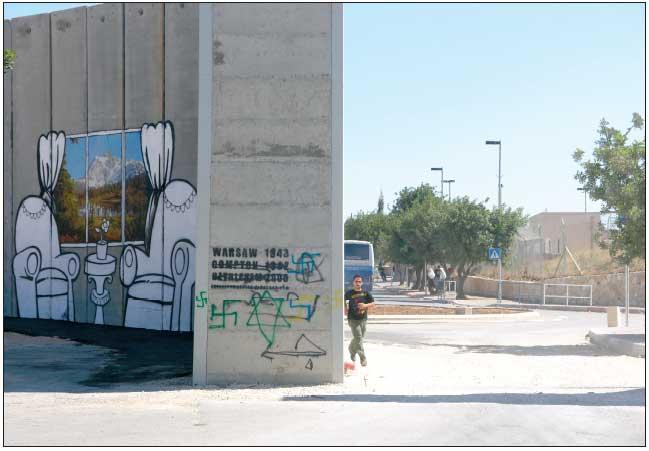 Muro en Belén con el grafiti de Bansky